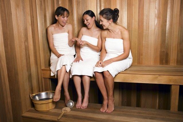 Women in sauna admiring engagement ring