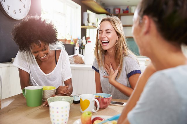 Three Female Friends Enjoying Breakfast At Home Together