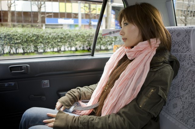 Japanese woman in taxi