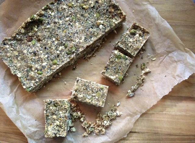 Homemade nut-and-seed energy bars on cutting board