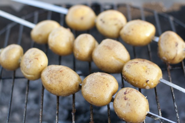 Young potatoes on the grill