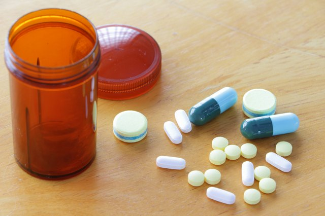 Medicine on wooden table