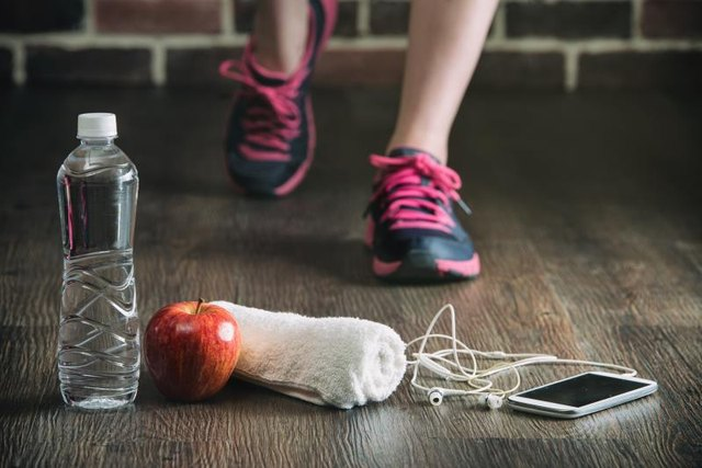 fitness running sports equipment, water phone music towel apple on wooden floor, healthy lifestyle