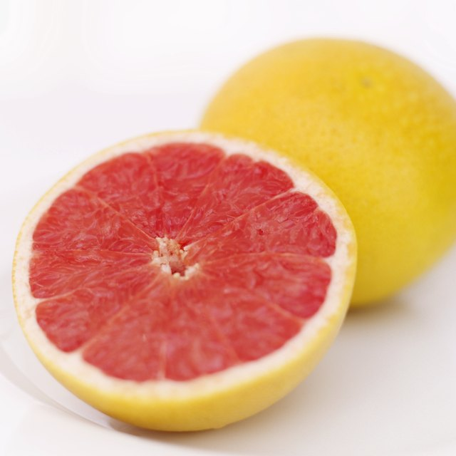 close-up of sliced grape fruit on a plate