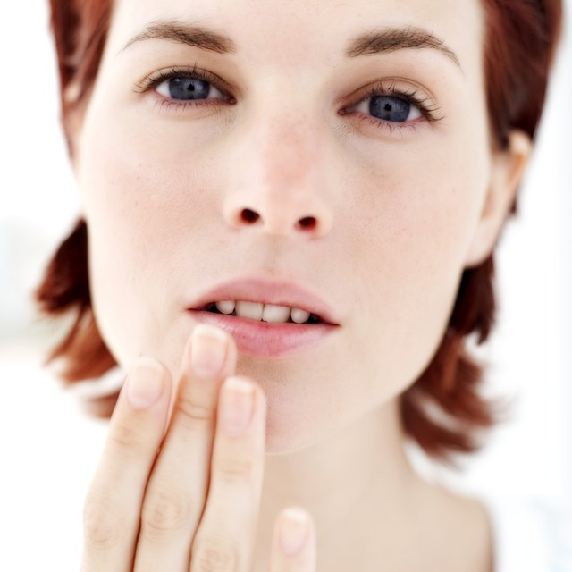 portrait of a woman touching her lip