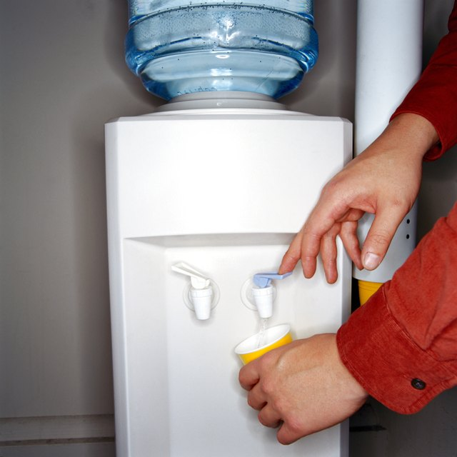 Man filling cup from water cooler