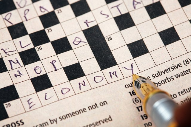 Pen on crossword puzzle, close up