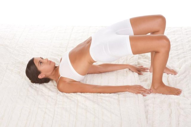 'yoga pose ''Bridge'' - female in sport clothes performing exercise    '