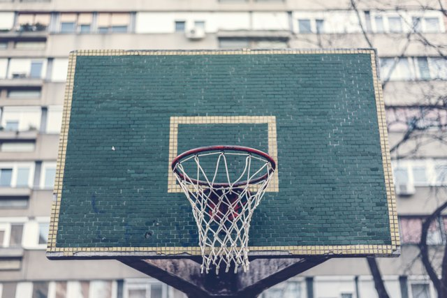 Basketball hoop with backboard in residential district