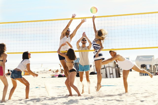 Friends playing volleybal