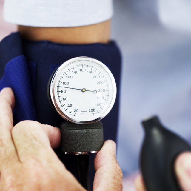 medical personnel checking blood pressure