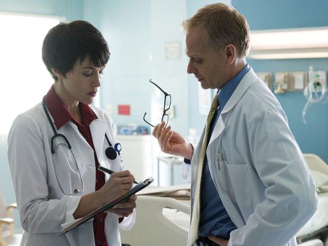 Doctor talking in hospital room