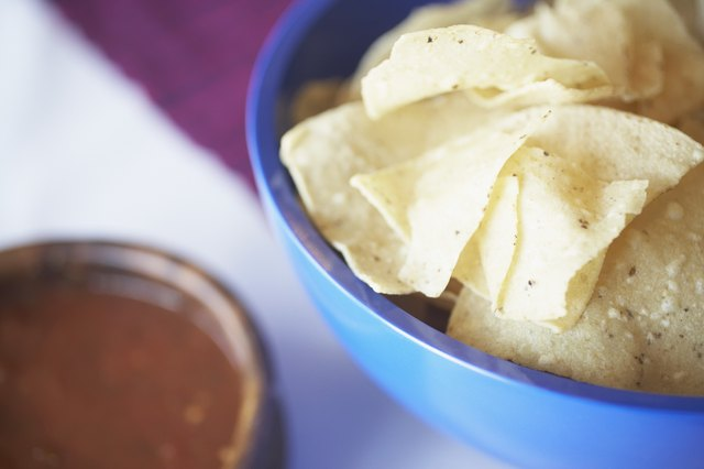 Tortilla chips and salsa, elevated view (focus on tortillas chips)