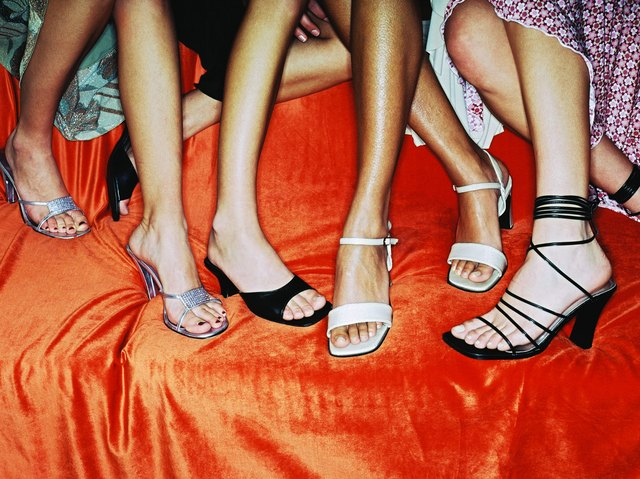close-up of the feet of a group of women sitting at a party