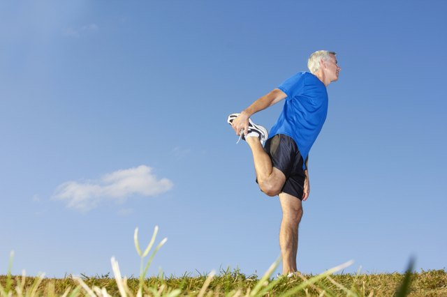 Mature Man Stretching Muscles