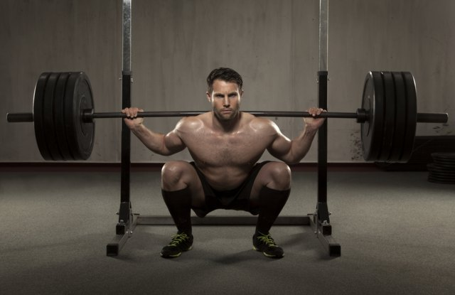 Athlete performing squat with barbell
