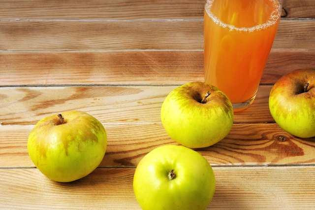 Green apples and apple juice in the glass