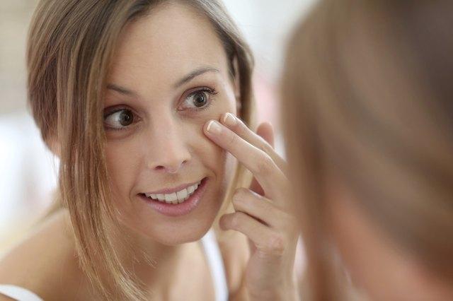 Brunette woman taking care of skin