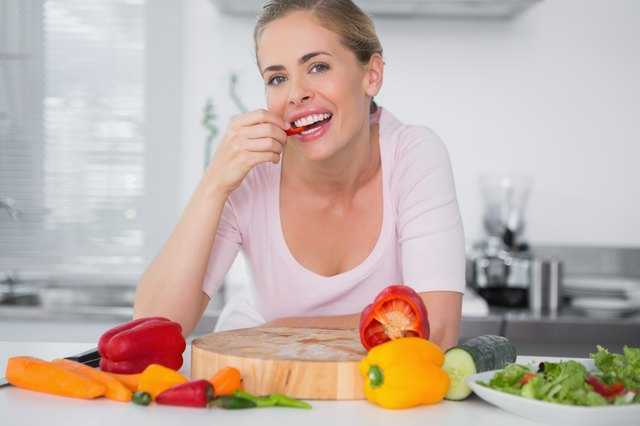 Attractive woman eating vegetables