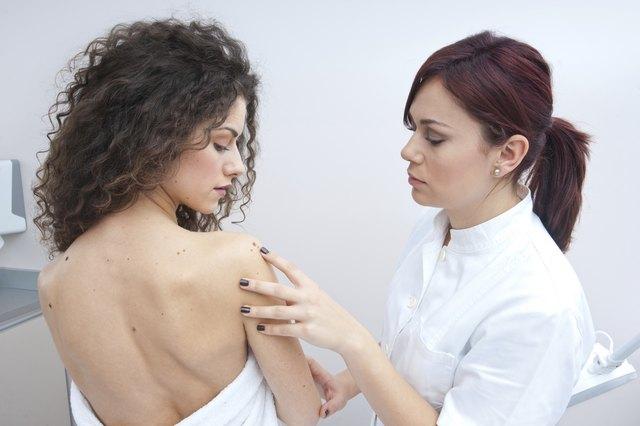 woman at dermatology examination