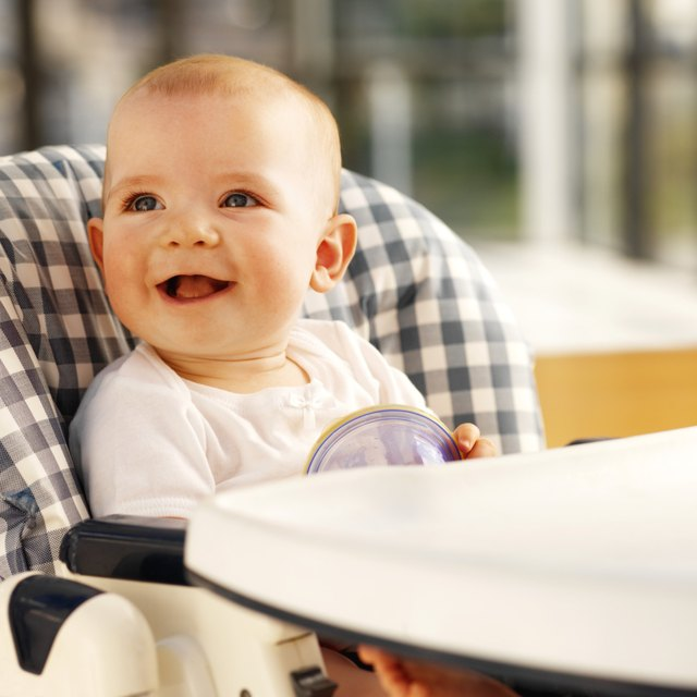 baby (12-18 months) sitting in high chair