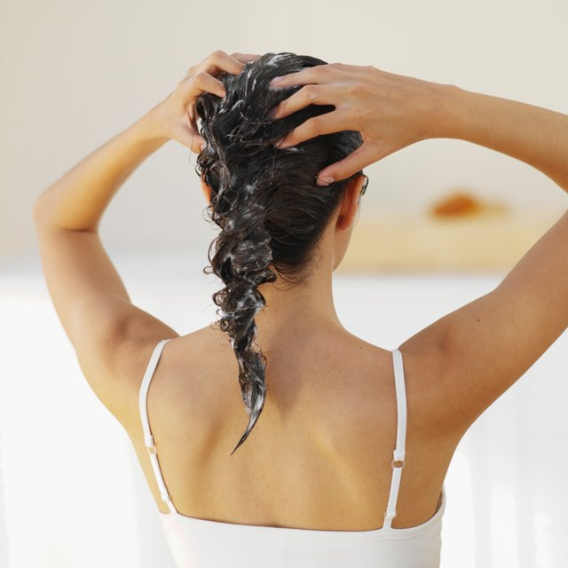 Rear view of a woman washing her hair