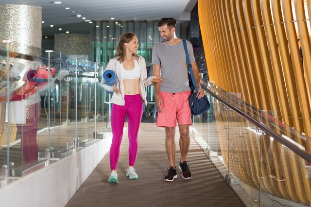 Smiling sporty couple walking and chatting