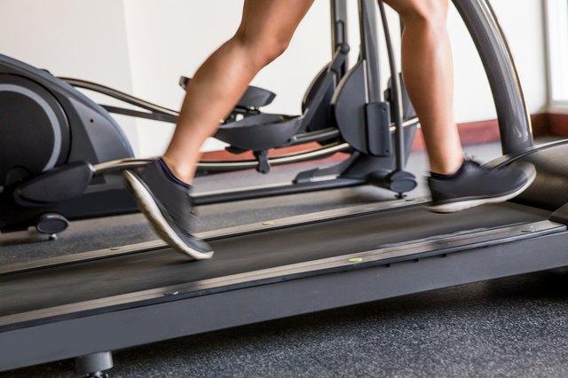 Man warming up on treadmill