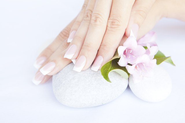woman hands with beautiful french manicure nails