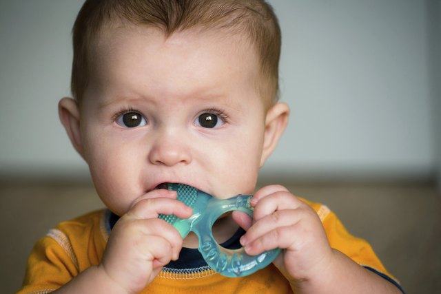 Baby chewing on teething ring