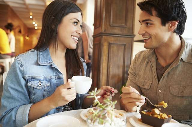 Couple Meeting In Busy Café Restaurant