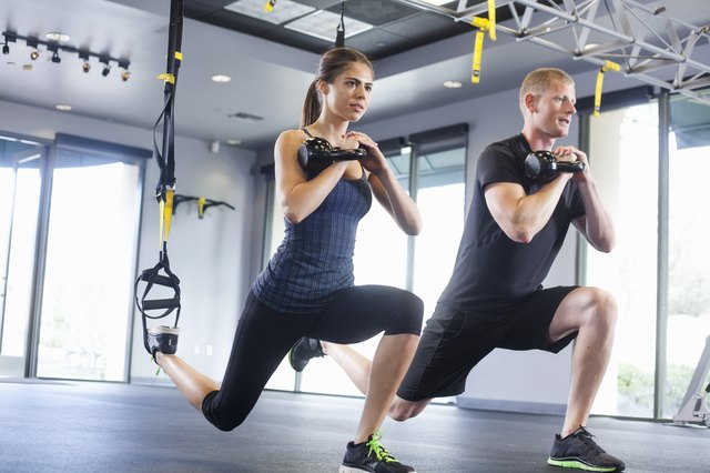Couple working out with weights