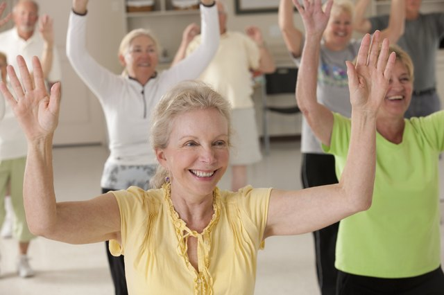 Seniors exercising with arm stretches