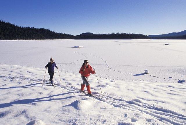 Two people skiing in a ski resort