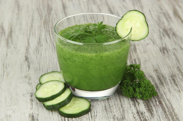 Green vegetable juice on table close-up