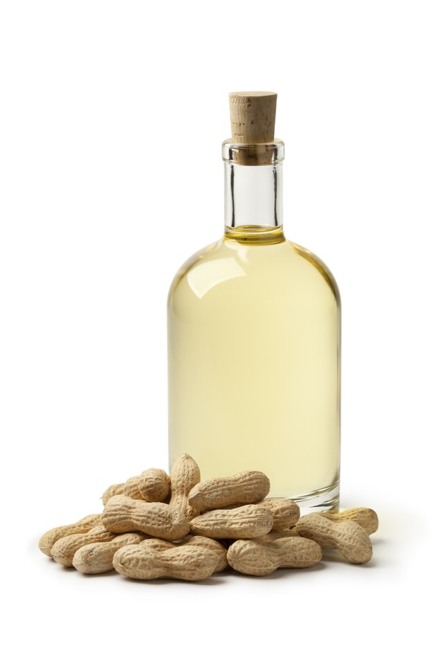 bottles of peanut oil with nuts