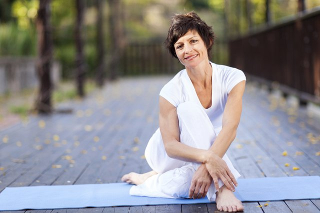 middle aged woman relaxing after workout