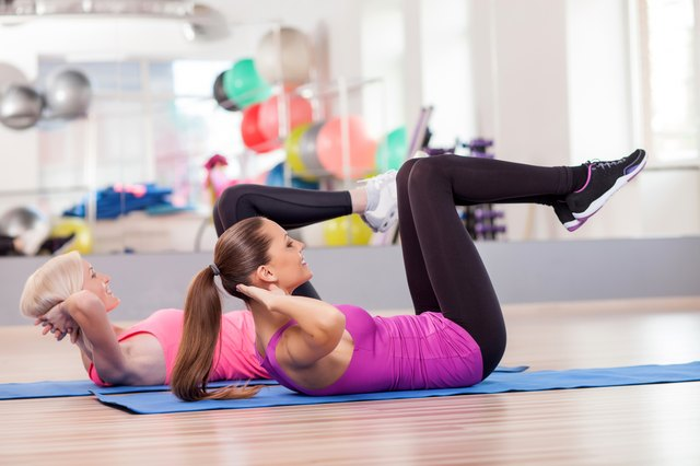 Attractive fit ladies are exercising in gym
