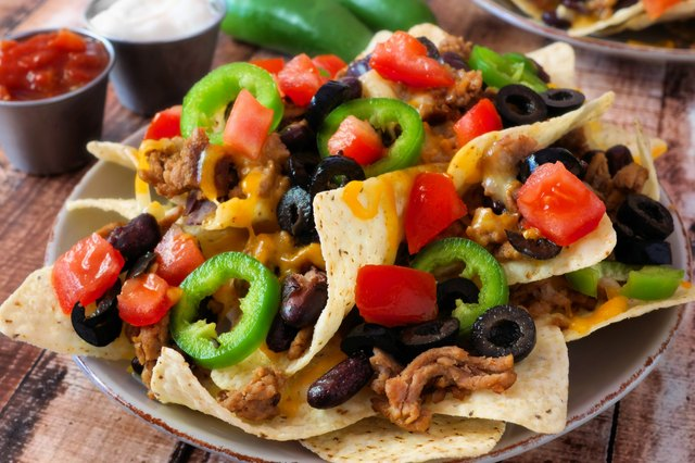 Plate of spicy fully loaded Mexican nachos