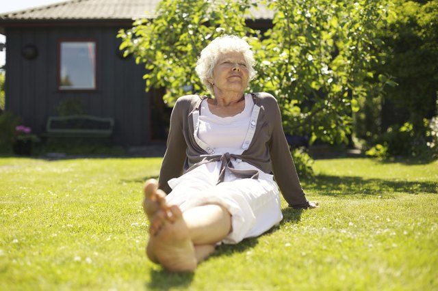 Senior woman enjoying the fresh air in garden
