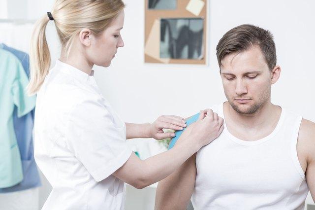 Physiotherapist applying kinesiology tape
