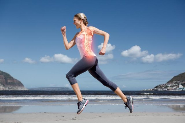 Digital composite of Highlighted back bones of jogging woman on beach