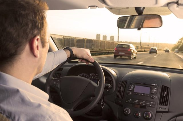 Businessman driving back home after exhausting day at work