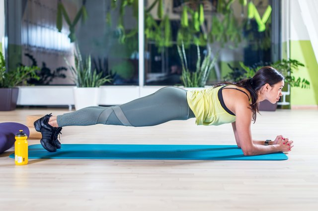 fitness training athletic sporty woman doing plank exercise in gym