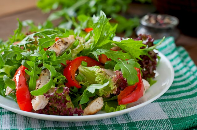 Dietary salad with chicken, arugula and sweet red pepper