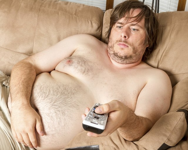 Fat lazy guy watching the TV