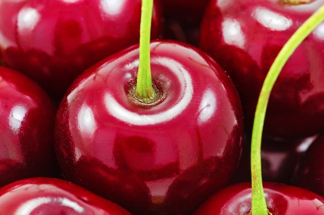 Sweet red cherries as a background
