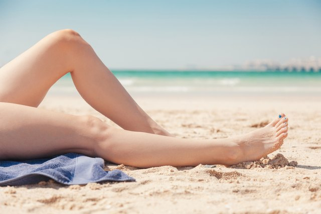Close Up Of Women's Legs On The Beach