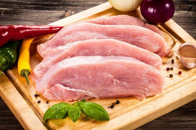 Raw turkey fillet on cutting board