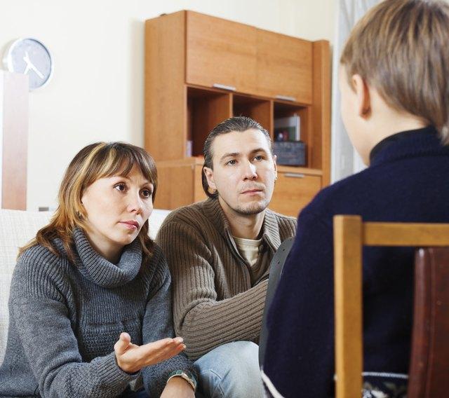 Parents scolding teenager